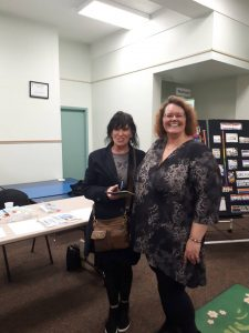 Lorraine Reguly and Linda Farmer (from PARO) at the Waverly Resource Library
