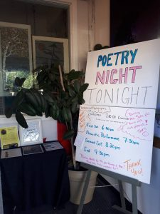 Poetry Night sign in the door at The Creative