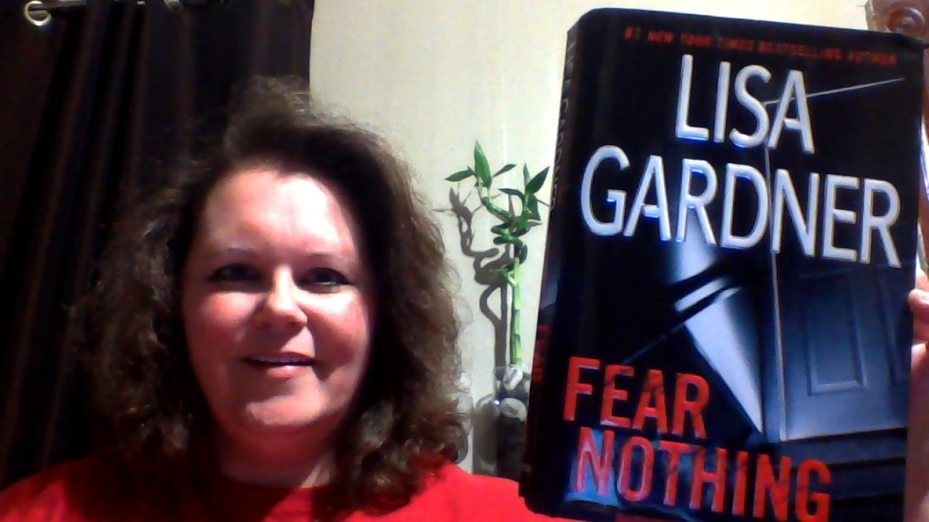 Me holding Lisa Gardner's book, Fear Nothing