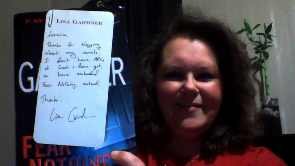 Me holding Lisa Gardner's note to me