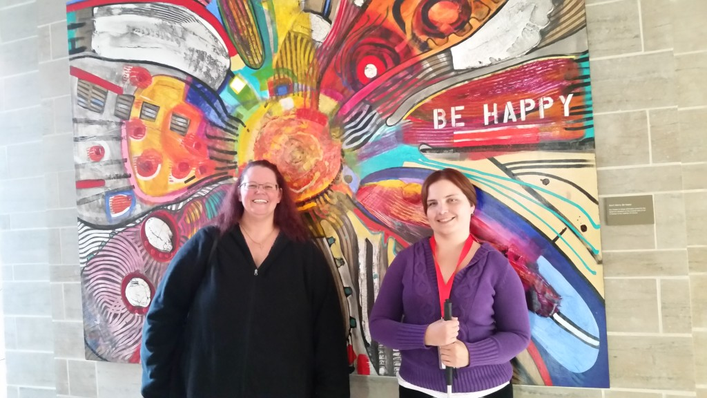 Kerri and I in front of the Be Happy painting at RMH