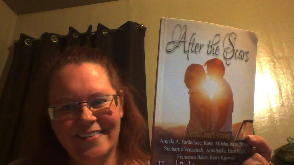 Me holding Kerri's book