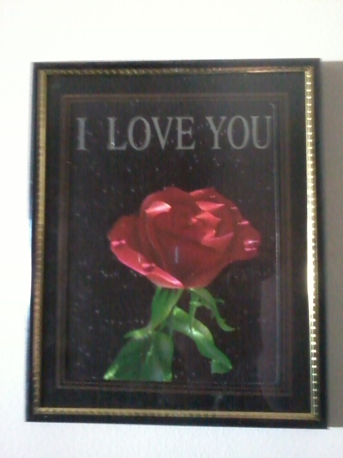 "a picture of a rose accompanied by the words ""I LOVE YOU"""